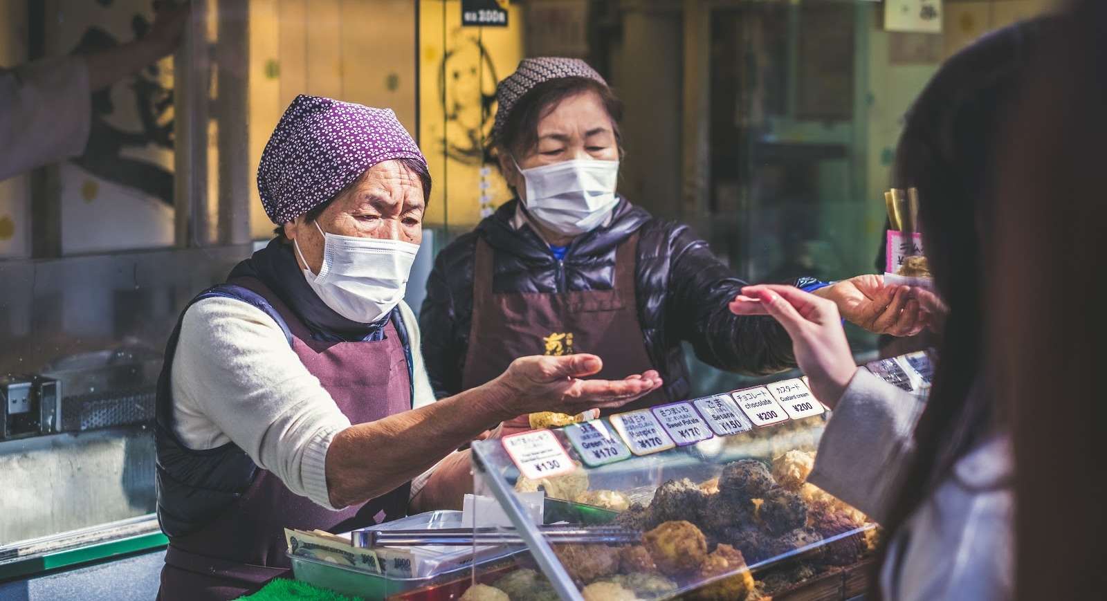 Women in a Chinese market wearing face masks for protection