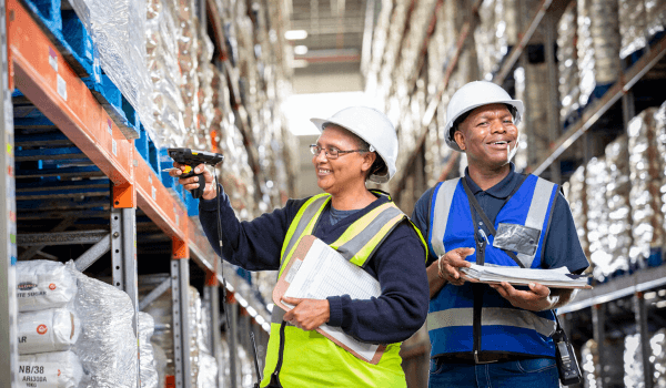 Woman and man working in warehouse
